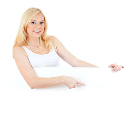 adorable blonde girl weared in tank top  pointing or displaying blank white board in her hands isolated studio shot Stock Photo - 10938135
