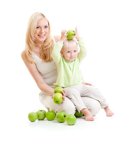 mother and son with green apples isolated Stock Photo - 10938141