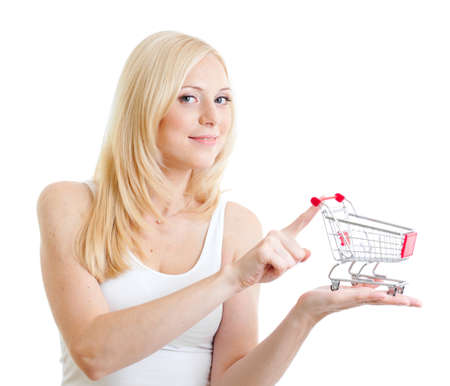 buy online: Blonde girl weared in white tank top with small shopping cart in hands isolated