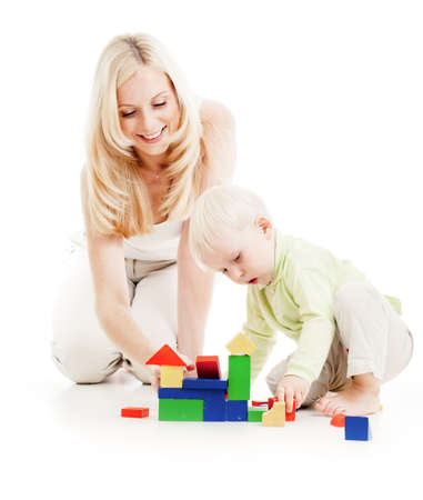 Mother and son playing building blocks together isolated on white photo