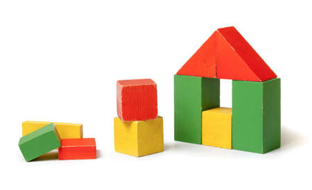 yellow block: Simple house made from colorful wooden building blocks
