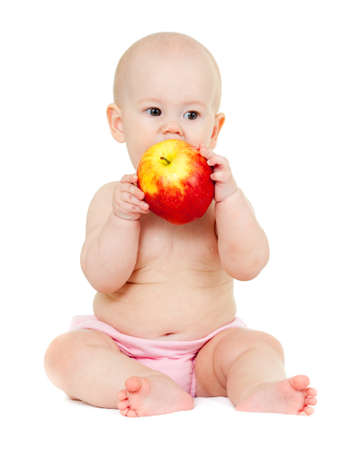 baby girl with red apple Stock Photo