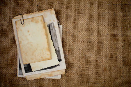 old photograph: old photos bunch over burlap texture as a template for your picture Stock Photo