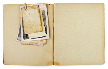 old notebook: blank old opened diary or copybook with photos bunch isolated on white