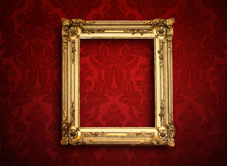 scrap gold: Empty golden painting frame on vintage wallpaper