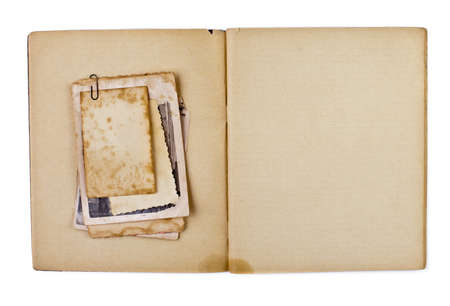 old photograph: blank old opened diary or copybook with photos bunch isolated on white