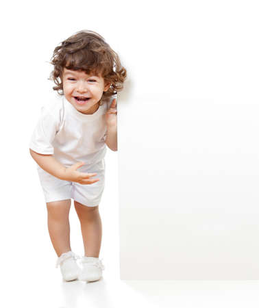 Curly funny girl holding blank advertising banner photo