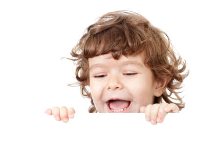 Curly funny child face holding blank advertising banner Stock Photo - 11057440