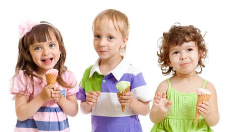 eating ice cream: happy children with ice cream in studio isolated