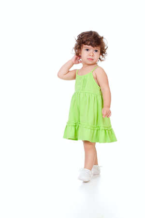 curly headed: Curly pensive little girl isolated on white