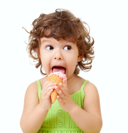 little curly girl with ice cream in studio isolated photo