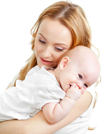 blonde mom: Happy young mother and baby in her hands Stock Photo