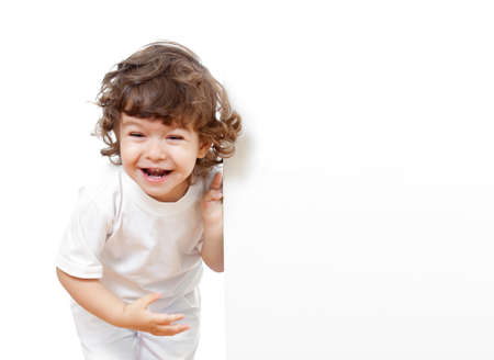 curly headed: Curly funny girl holding blank advertising banner Stock Photo