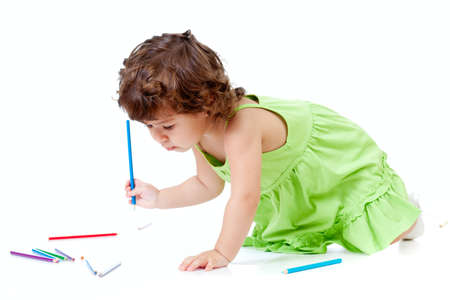curly headed: Little emotional girl with green pencil and big copyspace isolated