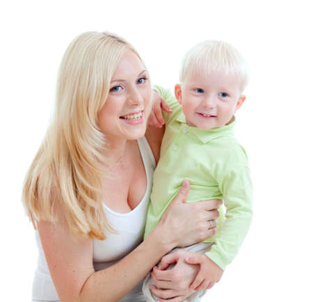 Happy adorable mother taking her  child in arms. Studio shot isolated. photo