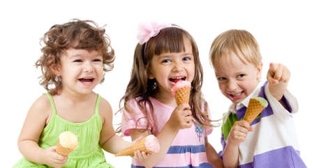 happy children group with ice cream in studio isolated photo