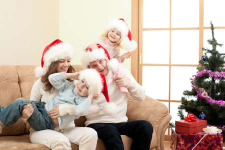 happy family in Christmas Santa photo