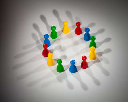 group of multi-colored people to represent social network, diversity, multi cultural society, team work togetherness photo