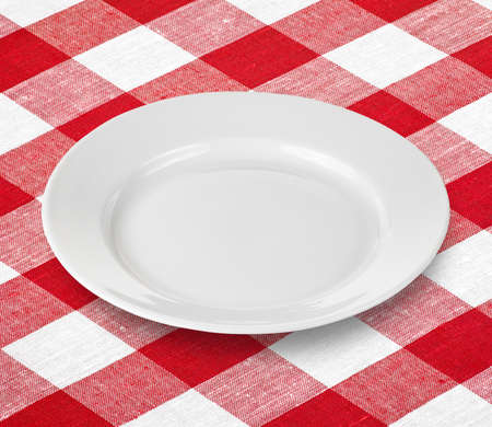 white empty plate on red gingham tablecloth Stock Photo - 11561259