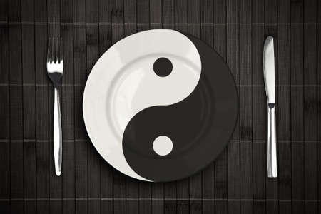 place mat: yin yan plate over bamboo placemat setting with fork and knife