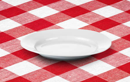 white empty plate on red gingham tablecloth photo
