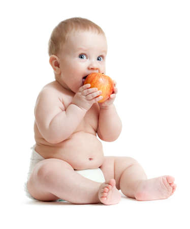 Baby boy eating healthy food isolated photo