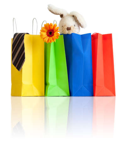 shopping bags with purchases for family on white background with reflection photo