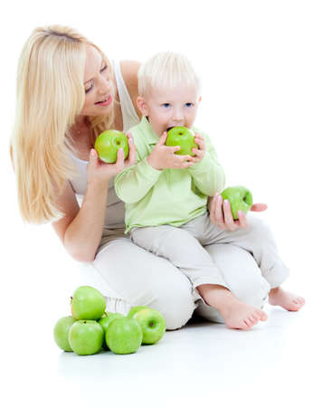 mother and son with green apples isolated photo