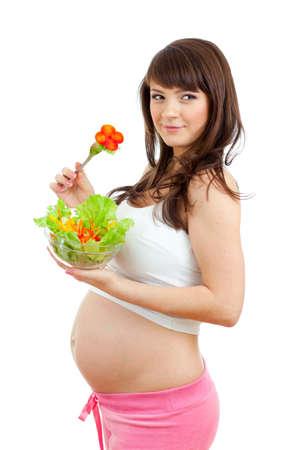 embarazada feliz: Mujer embarazada ingiere alimentos saludables Foto de archivo