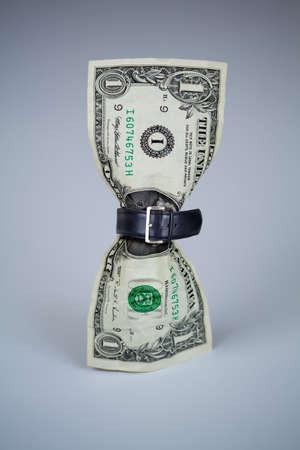 austerity: tighten belt on dollar concept Stock Photo