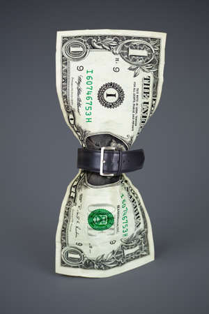 budget crisis: tighten belt on dollar concept Stock Photo