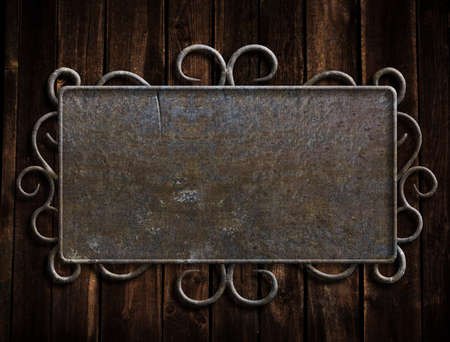Vintage metal plate  on old oak door photo