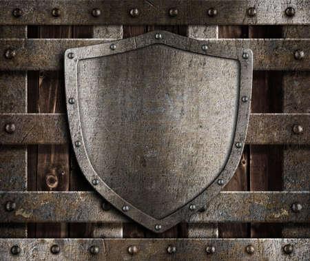 metal grate: aged metal shield on wooden medieval gates