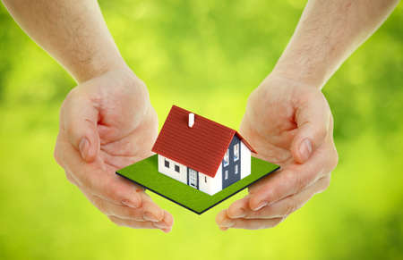 plot: Hands brings small house outdoor