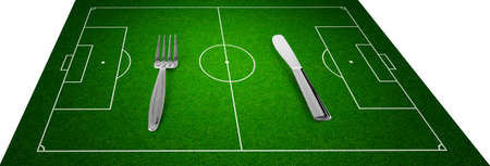 crossbars: knife and fork on football field concept Stock Photo