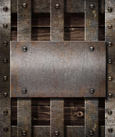metal grate: aged metal plate on wooden medieval background Stock Photo