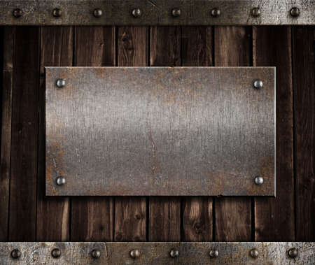 metal plate: metal plate  on old wooden wall or door