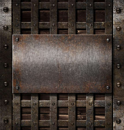 aged metal plate on wooden medieval background Stock Photo