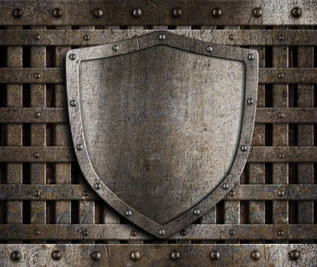 aged metal shield on wooden medieval gates photo