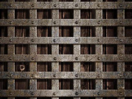 rejas de hierro: Jaula de metal sobre fondo de madera