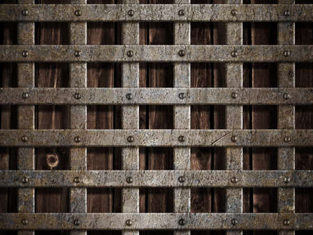 metal grate: metal cage on wood background Stock Photo