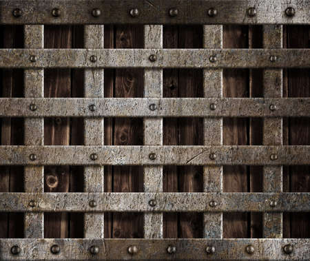 metal cage on wood background Stock Photo - 12202048