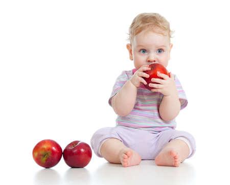 baby feeding: Baby boy eating healthy food isolated Stock Photo