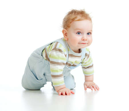 to creep: adorable boy crawls on all fours studio shot Stock Photo