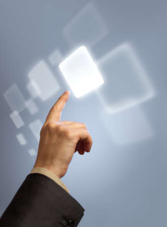 touch down: Hand pressing abstract virtual button on touchscreen Stock Photo