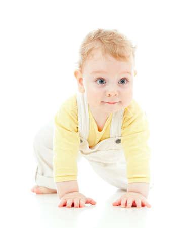 floor standing: adorable boy crawls on all fours studio shot Stock Photo