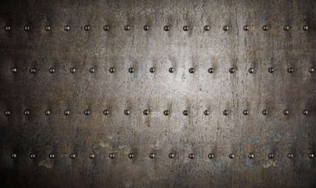 armour metal background with rivets photo