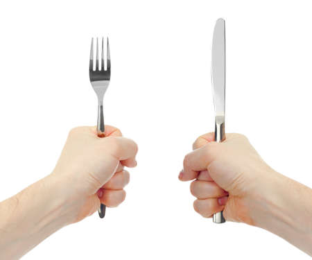 knife and fork cutlery in hands isolated photo