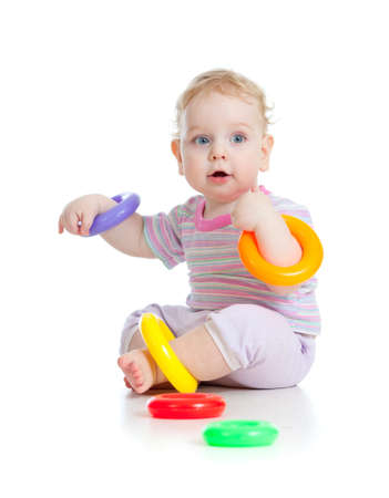 babies with toys: Cute little boy playing colorful toys isolated on white Stock Photo