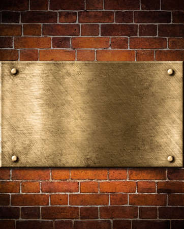 old golden or bronze plate on brick wall photo